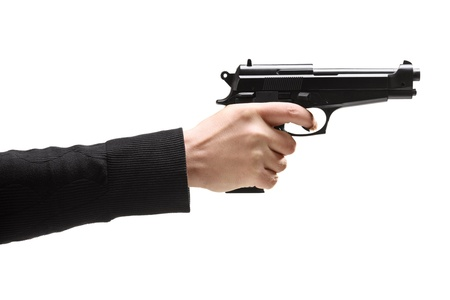Robber holding a gun isolated against white background photo