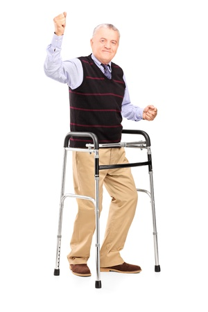walkers: Full length portrait of a happy mature gentleman with walker gesturing happiness isolated on white background Stock Photo