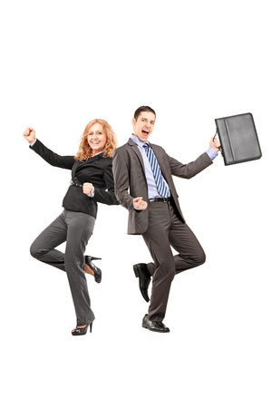 Full length portrait of a happy businesspeople gesturing happiness isolated on white background photo