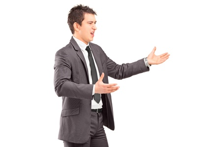 disagree: Young professional man in a suit arguing isolated on white background