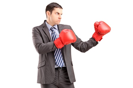 Angry man in suit with red boxing gloves ready to fight isolated on white background photo