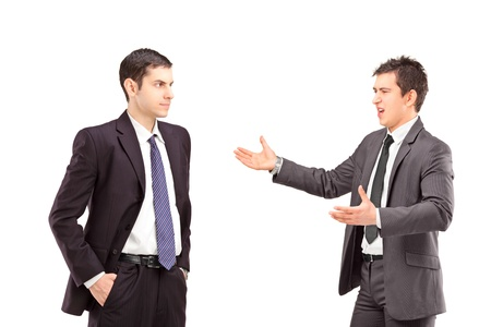 Two persons having a confrontation isolated on white background photo