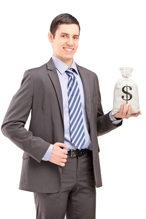 Happy young businessman holding a bag with US dollar sign, isolated on white background photo