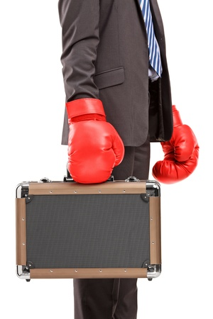 Businessman holding a briefcase with red boxer gloves isolated on white background photo