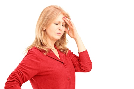 sad old woman: Mature woman having a headache isolated on white background Stock Photo