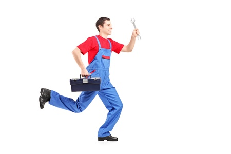 man profile: Full length portrait of a repairman running with a wrench and a tool box isolated on white background Stock Photo