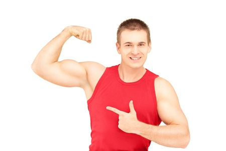 Muscular young man showing his biceps isolated on white background photo