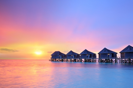 tourist resort: Sunset on Maldives island, water villas resort Editorial