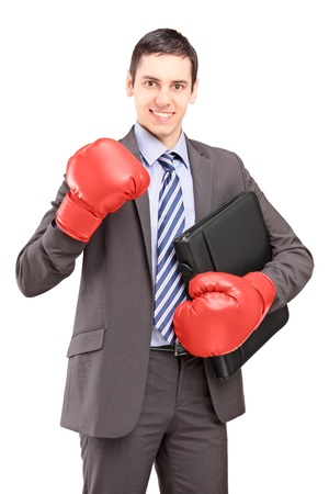 Young businessman with red boxing gloves holding a briefcase isolated on white background photo
