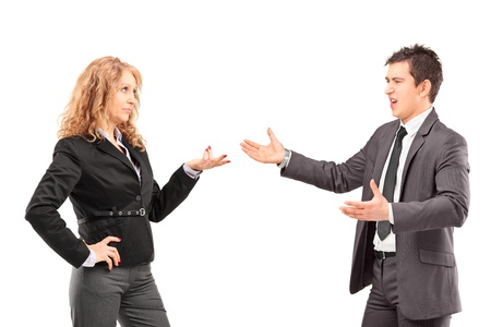 Businesswoman having an argument with a young businessman isolated against white background photo