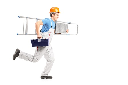 fast service: Full length portrait of a repairman running with a ladder and a tool box isolated against white background