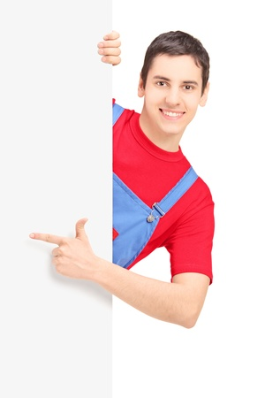 Repairman pointing on a blank panel isolated against white background photo