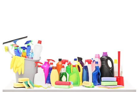 household cleaning: Studio shot of a cleaning supplies on a table isolated on white background