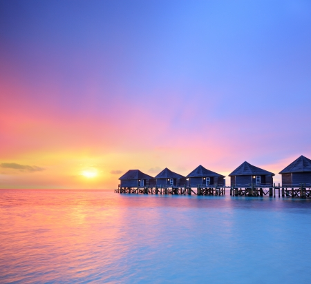 View of a beautiful sunset on a Malidves island and water villas, shot with a tilt and shift lens