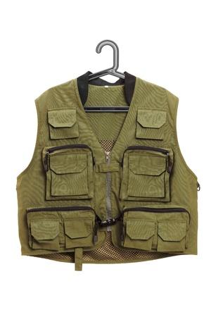 vest: Dark green hunter vest on a hanger isolated on white background