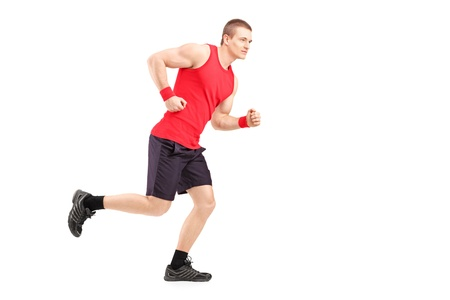 Full length portrait of a fit muscular male athlete running isolated on white background