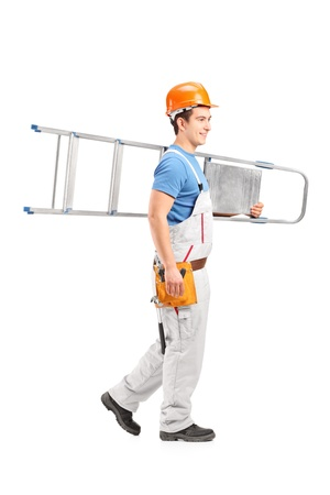 Full length portrait of a repairman with a helmet carrying a ladder isolated on white background Stock Photo - 18244957