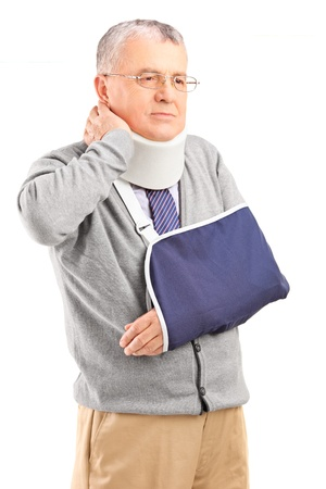 senior man on a neck pain: Senior man in pain wih a broken arm holding his neck isolated on white background