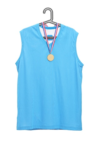Sport jersey and a golden medal hanging on a hanger isolated on white background photo