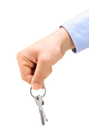 A male hand holding keys on a key ring, isolated on white background Stock Photo - 18268208