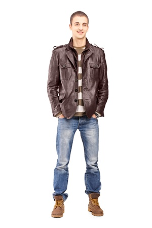 Full length portrait of a young smiling man posing isolated on white background Stock Photo