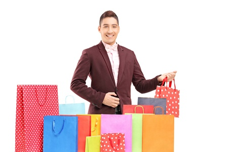 Handsome young man with many shopping bags, isolated on white background Stock Photo - 18388677
