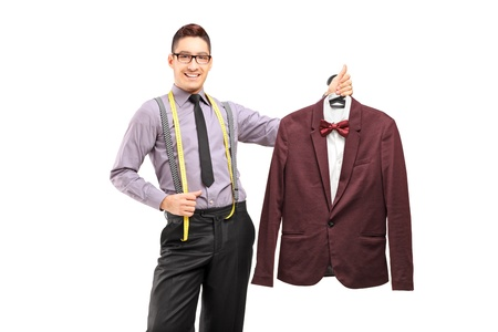 Male fashion designer holding a suit on a hanger, isolated on white background photo