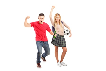 encourage: Full length portrait of a male and female football supporters, isolated on white background Stock Photo