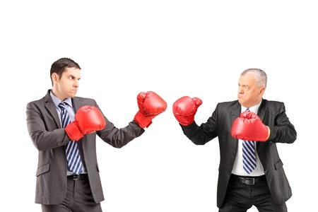 brawl: Two businessmen having a fight with boxing gloves, isolated on white background