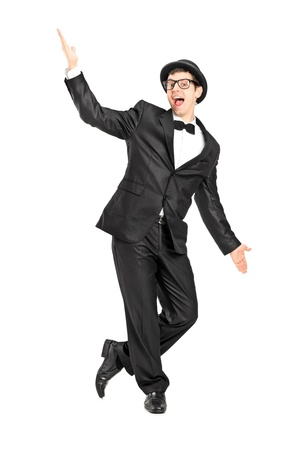 tuxedo man: Full length portrait of a man in a bow tie suit dancing isolated on white background Stock Photo