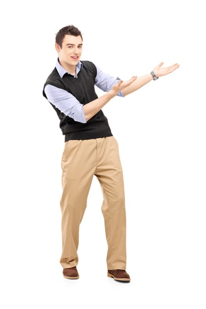 Full length portrait of a young cheerful man gesturing isolated on white background Stock Photo - 18299397