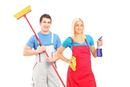 Cleaning team: Male and female cleaners with cleaning supplies posing isolated on white background