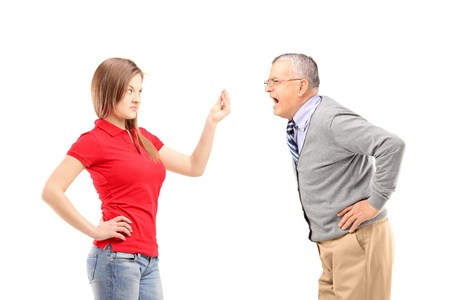 man scolding: Angry father shouting at his daughter isolated on white background Stock Photo