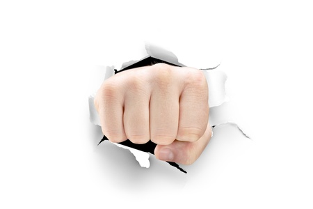 punch holes: Male fist breaking through a white paper isolated on white background Stock Photo