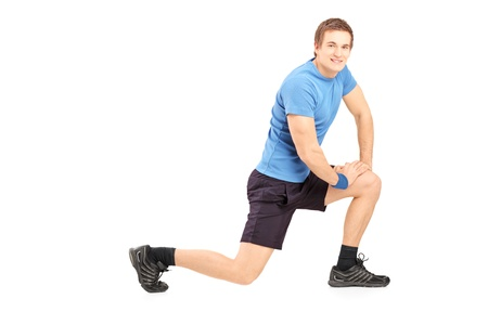 Young fit man exercising isolated on white background Stock Photo - 18348501