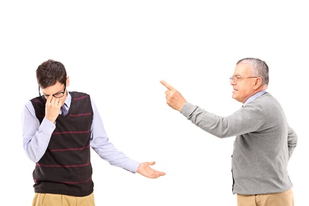 demanding: Angry mature man having an argument with a younger upset man isolated on white background