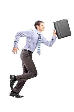 Full length portrait of a businessman running with a briefcase isolated on white background photo