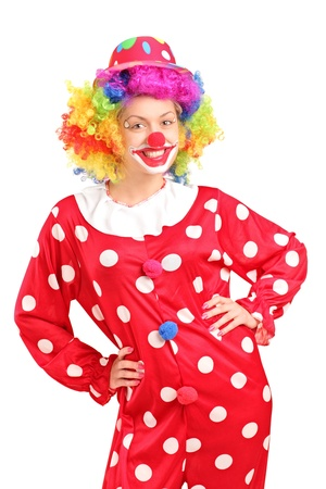 clown ': Smiling female clown in a red costume posing isolated against white background