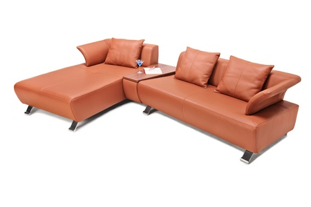 Studio shot of a luxury brown leather sofa isolated against white background Stock Photo - 18546100