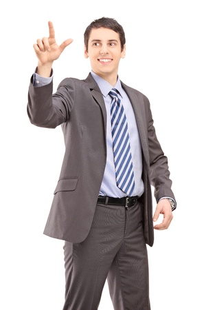 Young businessman touching something imaginery isolated on white background