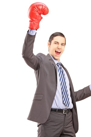 to raise: A happy young businessman with red boxing gloves gesturing happiness isolated against white background Stock Photo