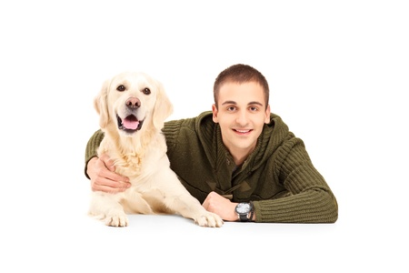 man dog: A young smiling man next to his best friend labrador dog isolated on white background