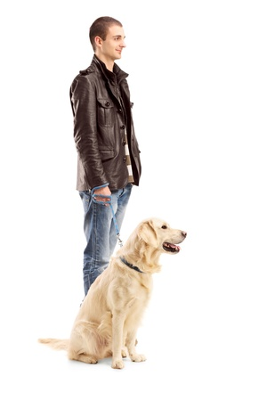 man dog: Full length portrait of a young man standing with a retriever dog isolated on white background Stock Photo