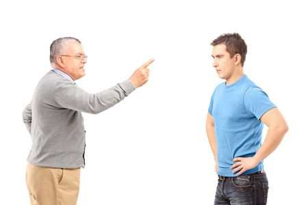 man scolding: Angry father reprimanding his son with finger isolated on white background
