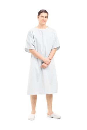 Full length portrait of a male patient in a hospital gown, isolated on white background Stock Photo