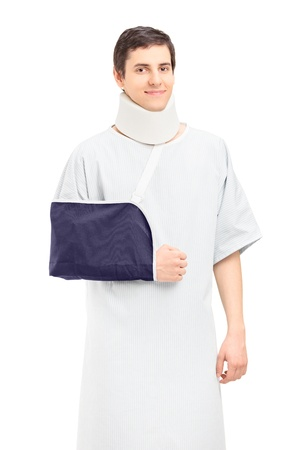 broken arm: A male patient with a broken arm and neck posing isolated on white background