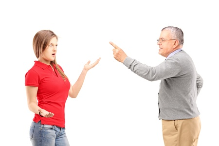 Angry father reprimanding his teenage daughter isolated on white background Stock Photo - 18666121