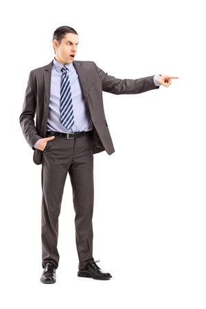 Full length portrait of an angry businessman pointing with his finger, isolated on white background photo