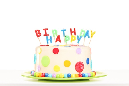 marzipan: Studio shot of a colorful decorated cake with happy birthday candles, isolated on white background Stock Photo