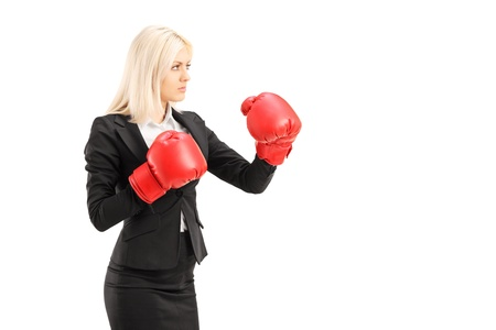 A young businesswoman with red boxing gloves ready to fight isolated on white background photo